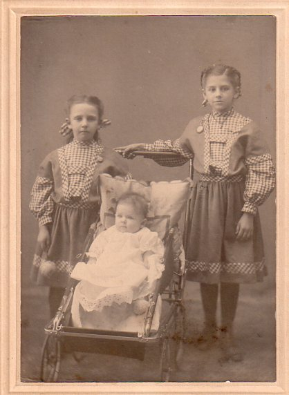 studio picture taken in South Whitley, Indiana in 1909. The baby is LeNore Alice Hoard Enz, my maternal grandmother. Behind her are her two sisters, Sarah Mae, left, and Zoe Trucia, right.